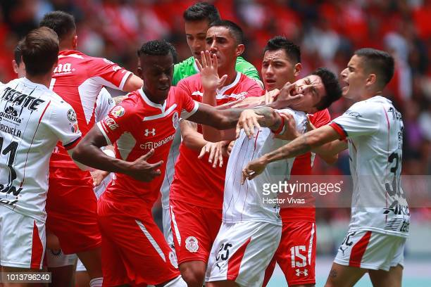 Cristian Borja of Toluca hits the face of Michael Perez of Chivas during the third round match between Toluca and Chivas as part of the Torneo...