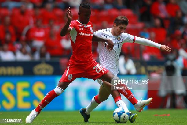 Cristian Borja of Toluca struggles for the ball with Isaac Brizuela of Chivas during the third round match between Toluca and Chivas as part of the...