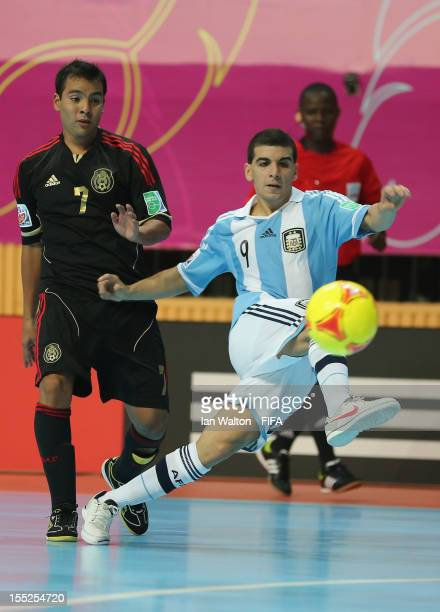 Cristian Borruto of Argentina scores a goal during the FIFA Futsal World Cup Thailand 2012 Group D match between Argentina and Mexico at Nimibutr...