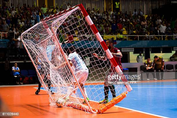 Cristian Borruto of Argentina scores the opening goal during the FIFA Futsal World Cup SemiFinal match between Argentina and Portugal at the Coliseo...