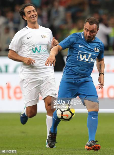 Cristian Brocchi is challenged by Alessandro Nesta during Andrea Pirlo Farewell Match at Stadio Giuseppe Meazza on May 21 2018 in Milan Italy