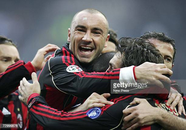 Cristian Brocchi of AC Milan celebrates Andrea Pirlo's goal with team mates during the Serie A match between AC Milan and Reggina at the San Siro...