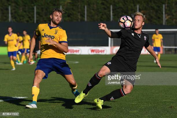 Cristian Bunino of Juventus second team competes with Lorenzo Grossi of Pro Vercelli during the joint training Juventus second team v Pro Vercelli on...