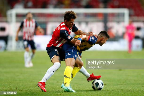 Cristian Calderon of Chivas fights for the ball with Jair Díaz of Atletico San Luis during the 1st round match between Chivas and Atletico San Luis...