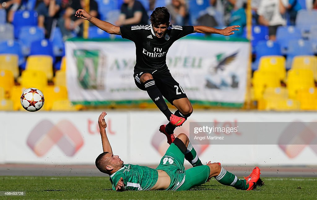 Cristian Cedres of Real Madrid Academy jumps over Aleksandar Georgiev of Ludogorets during the UEFA Youth Champions League match between PFC Ludogorets Razgrad and Real Madrid at Georgi Asparuhov Stadion on October 1, 2014 in Sofia, Bulgaria.
