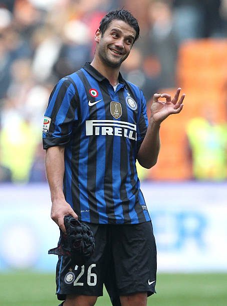 Cristian chivu photos pictures of cristian chivu getty images cristian chivu of fc internazionale milano celebrates victory at the end of the serie a match thecheapjerseys Image collections
