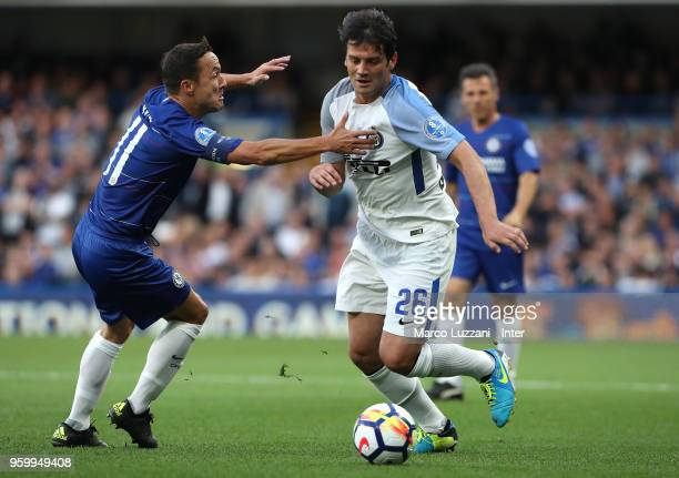 Cristian Chivu of Inter Forever competes for the ball with Dennis Wise of Chelsea Legends during Chelsea Legends v Inter Forever at Stamford Bridge...
