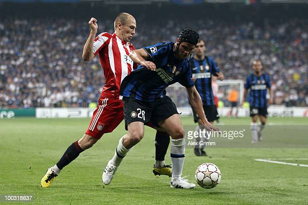 Cristian Chivu of Inter Milan is challenged by Arjen Robben of Bayern Muenchen during the UEFA Champions League Final match between FC Bayern...