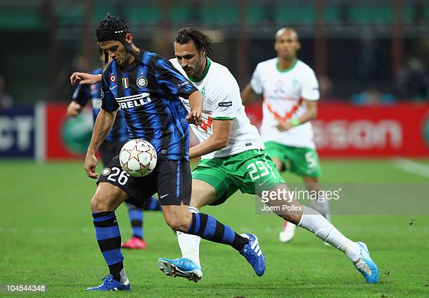 Cristian Chivu of Milano and Hugo Almeida of Bremen battle for the ball during the UEFA Champions League group A match between FC Internazionale...