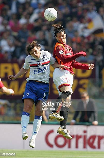 Cristian Chivu of Roma in action against Vitali Kutuzov of Sampdoria during the Serie A match between Roma and Sampdoria at the Stadio Olimpico on...