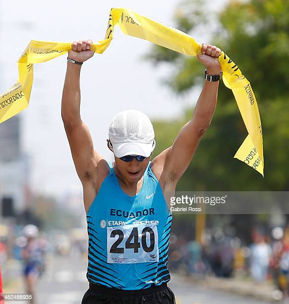 Cristian Chocho of Ecuador crosses the finish line in 50k walk race as part of the XVII Bolivarian Games Trujillo 2013 at Juan Pablo Street on...