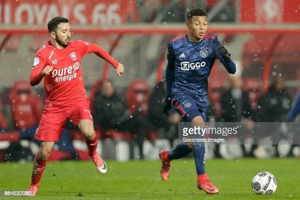 Cristian Cuevas of FC Twente David Neres of Ajax during the Dutch Eredivisie match between Fc Twente v Ajax at the De Grolsch Veste on December 2...