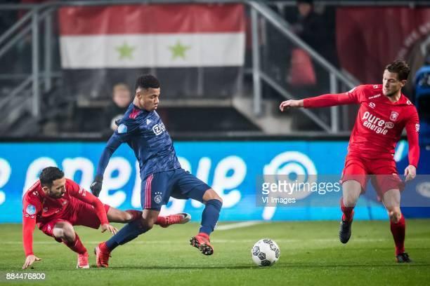 Cristian Cuevas of FC Twente David Neres of Ajax Hidde ter Avest of FC Twente during the Dutch Eredivisie match between FC Twente Enschede and Ajax...