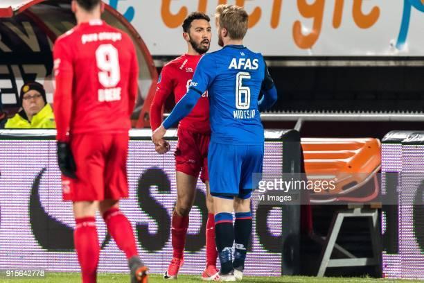Cristian Cuevas of FC Twente Fredrik Midtsjo of AZ during the Dutch Eredivisie match between FC Twente Enschede and AZ Alkmaar at the Grolsch Veste...