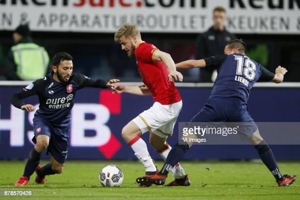 Cristian Cuevas of FC Twente Fredrik Midtsjo of AZ Michael Liendl of FC Twente during the Dutch Eredivisie match between AZ Alkmaar and FC Twente...