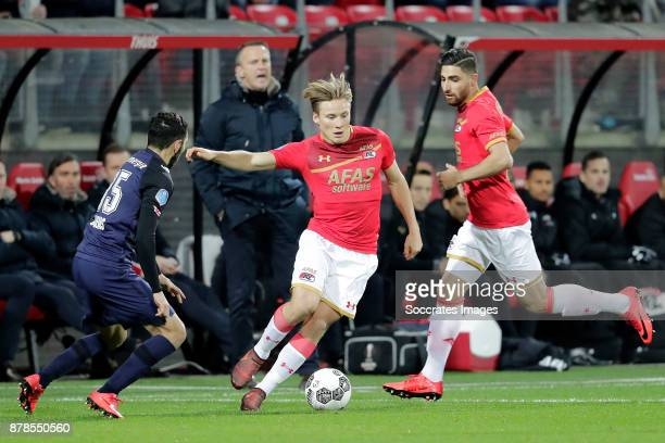 Cristian Cuevas of FC Twente Jonas Svensson of AZ Alkmaar during the Dutch Eredivisie match between AZ Alkmaar v Fc Twente at the AFAS Stadium on...