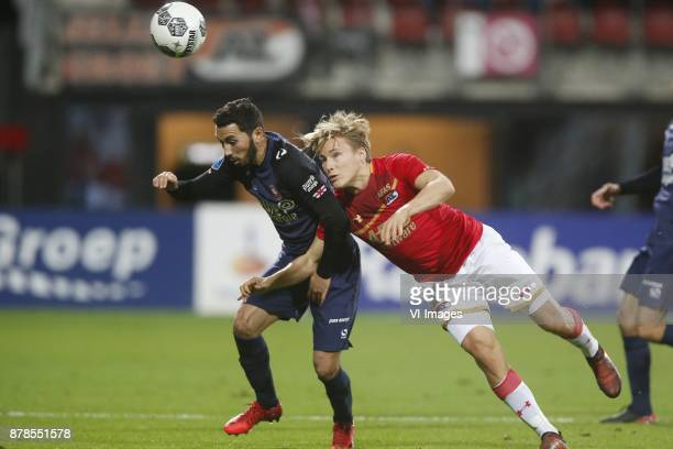 Cristian Cuevas of FC Twente Jonas Svensson of AZ during the Dutch Eredivisie match between AZ Alkmaar and FC Twente Enschede at AFAS stadium on...
