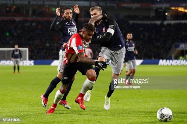 Cristian Cuevas of FC Twente Jurgen Locadia of PSV Stefan Thesker of FC Twente during the Dutch Eredivisie match between PSV v Fc Twente at the...