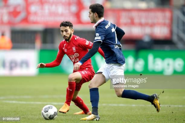 Cristian Cuevas of FC Twente Loris Brogno of Sparta Rotterdam during the Dutch Eredivisie match between Fc Twente v Sparta at the De Grolsch Veste on...