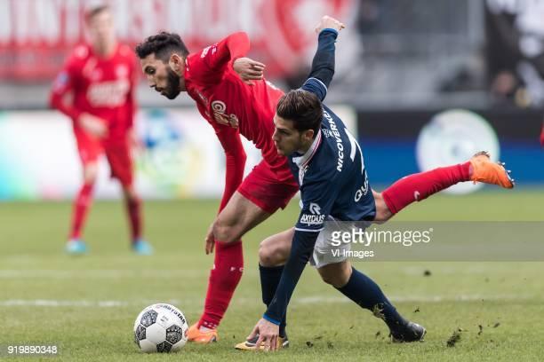 Cristian Cuevas of FC Twente Loris Brogno of Sparta Rotterdam during the Dutch Eredivisie match between FC Twente Enschede and Sparta Rotterdam at...