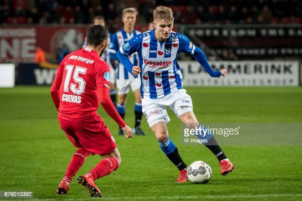 Cristian Cuevas of FC Twente Martin Odegaard of sc Heerenveen during the Dutch Eredivisie match between FC Twente Enschede and sc Heerenveen at the...