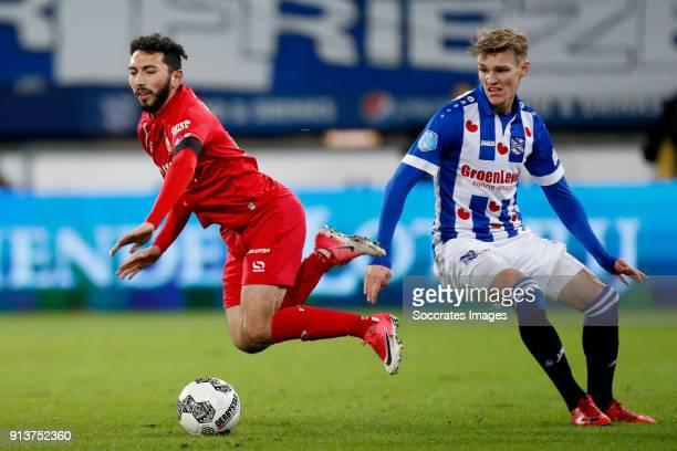 Cristian Cuevas of FC Twente Martin Odegaard of SC Heerenveen during the Dutch Eredivisie match between SC Heerenveen v Fc Twente at the Abe Lenstra...
