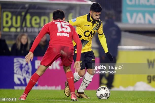 Cristian Cuevas of FC Twente Paolo Fernandes of NAC Breda during the Dutch Eredivisie match between NAC Breda v Fc Twente at the Rat Verlegh Stadium...
