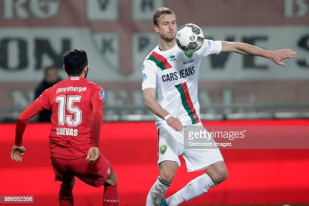 Cristian Cuevas of FC Twente Thomas Meissner of ADO Den Haag during the Dutch Eredivisie match between Fc Twente v ADO Den Haag at the De Grolsch...