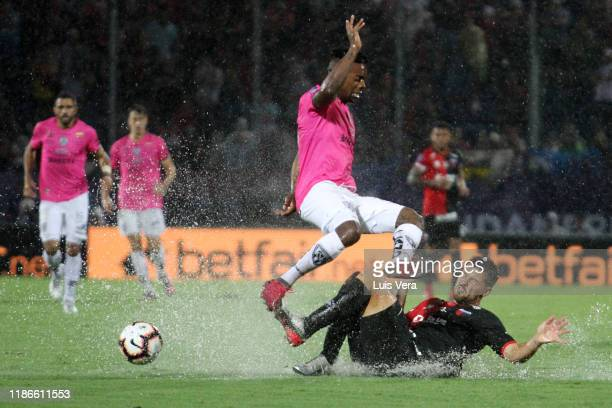 Cristian Dajome of Independiente del Valle jumps over Federico Lertola of Colon during the final of Copa CONMEBOL Sudamericana 2019 between Colon and...