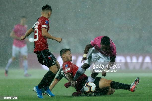 Cristian Dajome of Independiente fights for the ball with against Federico Lertola of Colon during the final of Copa CONMEBOL Sudamericana 2019...