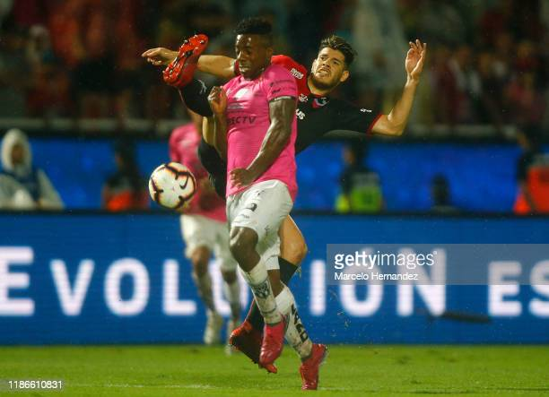 Cristian Dajome of Independiente fights for the ball with Guillermo Ortiz of Colon during the final of Copa CONMEBOL Sudamericana 2019 between Colon...