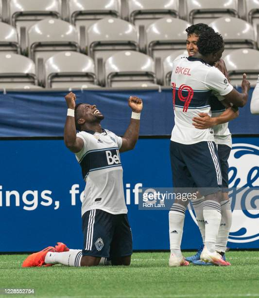 Cristian Dajome of the Vancouver Whitecaps celebrates after scoring a goal against the Montreal Impact during MLS soccer action at BC Place on...