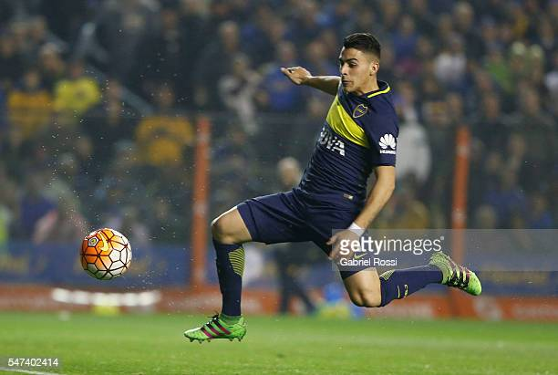 Cristian David Pavon of Boca Juniors kicks the ball to scores the first goal of his team during a second leg match between Boca Juniors and...