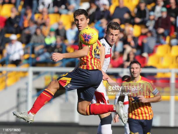 Cristian Dell'Orco of Lecce competes for the ball in air with Andrea Pinamonti of Genoa during the Serie A match between US Lecce and Genoa CFC at...
