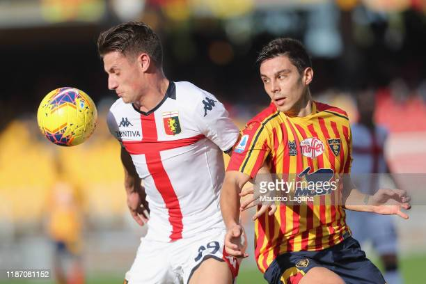 Cristian Dell'Orco of Lecce competes for the ball with Andrea Pinamonti of Genoa during the Serie A match between US Lecce and Genoa CFC at Stadio...