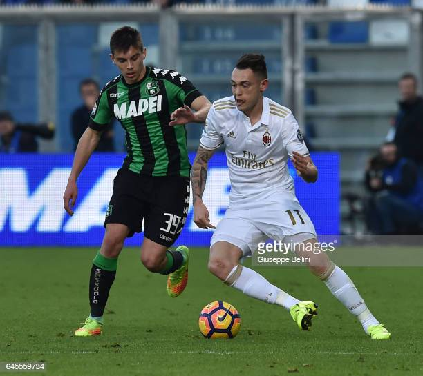 Cristian Dell'Orco of US Sassuolo and Lucas Ocampos of AC Milan in action during the Serie A match between US Sassuolo and AC Milan at Mapei Stadium...