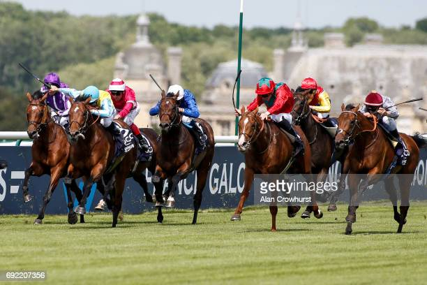 Cristian Demuro riding Brametot win The Qipco Prix Du Jockey Club from Waldgeist at Chantilly racecourse on June 4, 2017 in Chantilly, France.