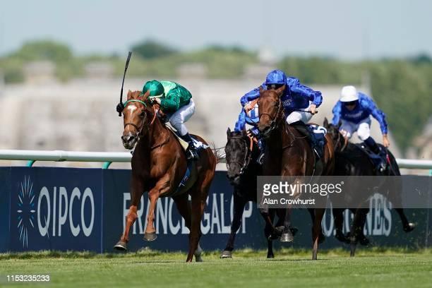 Cristian Demuro riding Sottsass win The Qipco Prix Du Jockey Club during The Qipco Prix du Jockey Club meeting at Hippodrome de Chantilly on June 02,...