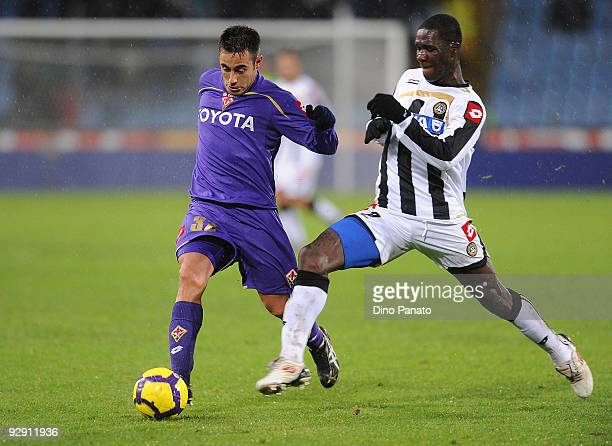 Cristian Edoardo Zapata Valencia of Udinese Calcio competes with Marco Marchionni of ACF Fiorentina during the Serie A match between Udinese Calcio...