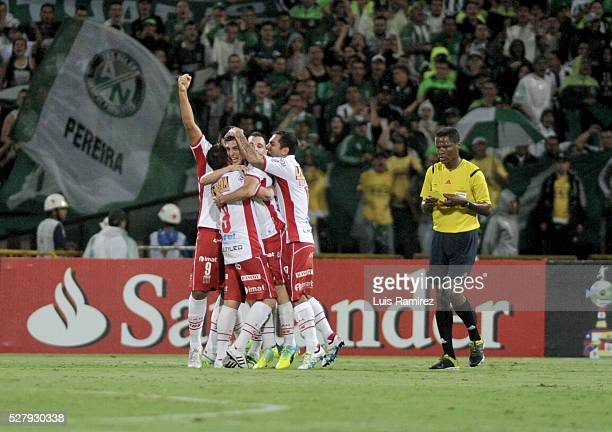 Cristian Espinoza of Huracan celebrates with teammates after scoring the first goal of his team during a second leg match between Atletico Nacional...