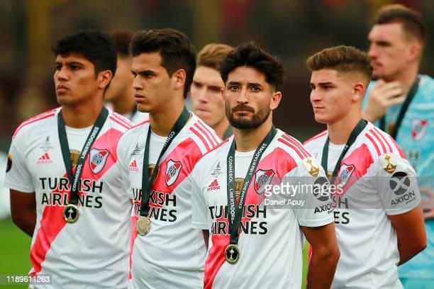 Cristian Ferreira Milton Casco and Julian Alvarez of River Plate look dejected after losing the final match of Copa CONMEBOL Libertadores 2019...