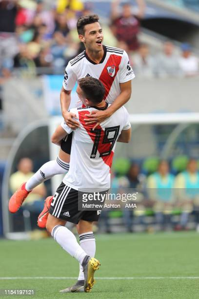 Cristian Ferreira of River Plate celebrates after scoring a goal to make it 02 with Rafael Santos during a friendly match between Club America and...