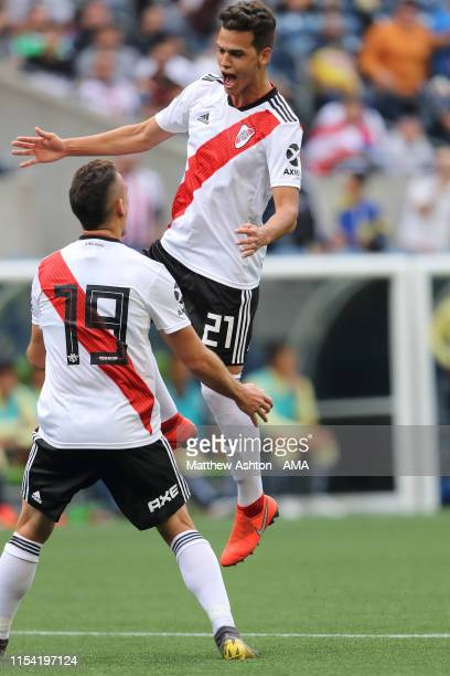 Cristian Ferreira of River Plate celebrates after scoring a goal to make it 0-2 with Rafael Santos during a friendly match between Club America and...