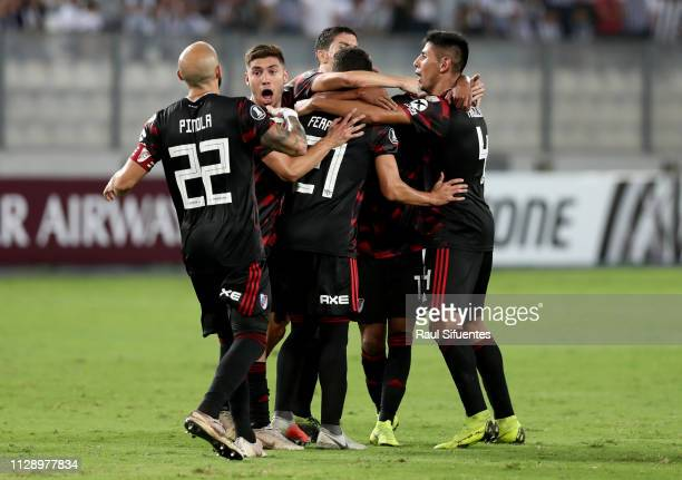 Cristian Ferreira of River Plate celebrates with teammates after scoring the equalizer during a group A match between Alianza Lima and River Plate as...