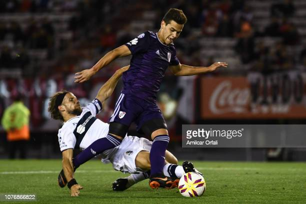 Cristian Ferreira of River Plate fights for the ball with Facundo Oreja of Gimnasia during a match between River Plate and Gimnasia y Esgrima La...
