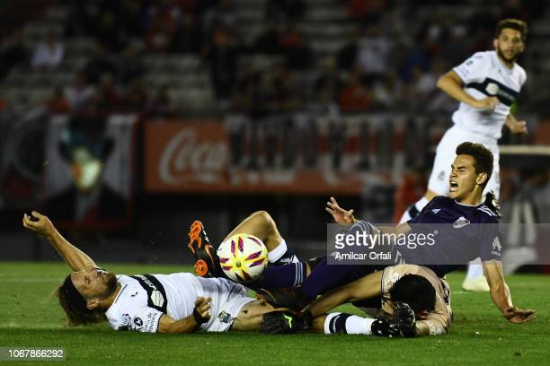 Cristian Ferreira of River Plate fights for the ball with Facundo Oreja and Sebastian Moyano of Gimnasia during a match between River Plate and...