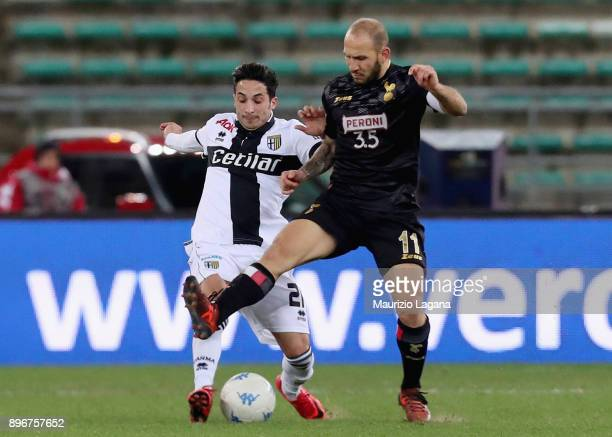 Cristian Galano of Bari competes for the ball with Matteo Scozzarella of Parma during the Serie B match between FC Bari and Parma Calcio at Stadio...