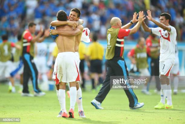 Cristian Gamboa and Oscar Granados of Costa Rica hug in celebration after defeating Italy 1-0 during the 2014 FIFA World Cup Brazil Group D match...