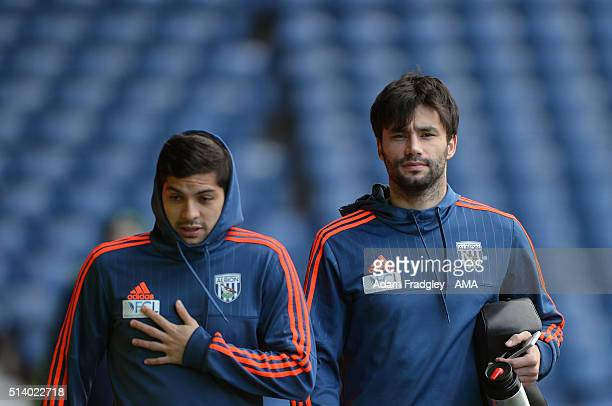 Cristian Gamboa & Claudio Yacob of West Bromwich Albion arrive prior to the Barclays Premier League match between West Bromwich Albion and Manchester...