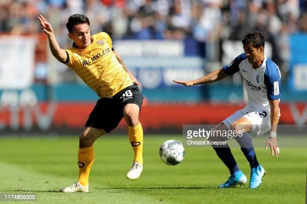 Cristian Gamboa of Bochum challenges Baris Atik of Dresden during the Second Bundesliga match between VfL Bochum 1848 and SG Dynamo Dresden at...